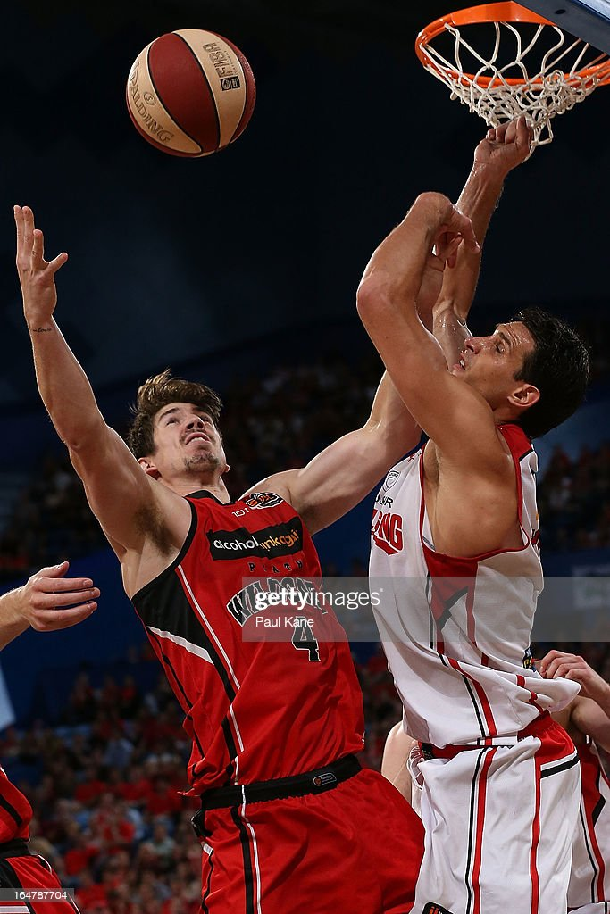 Greg Hire of the Wildcats contests for a rebound against Oscar Forman of the Hawks during game one of the NBL Semi Final Series between the Perth Wildcats and the Wollongong Hawks at Perth Arena on March 28, 2013 in Perth, Australia.