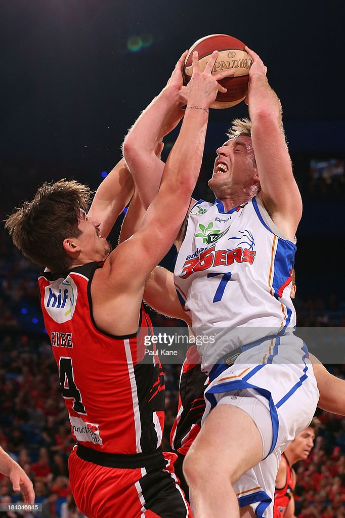 Greg Hire of the Wildcats fouls Brendan Teys of the 36ers during the round one NBL match between the Perth Wildcats and the Adelaide 36ers at Perth Arena in October 11, 2013 in Perth, Australia.