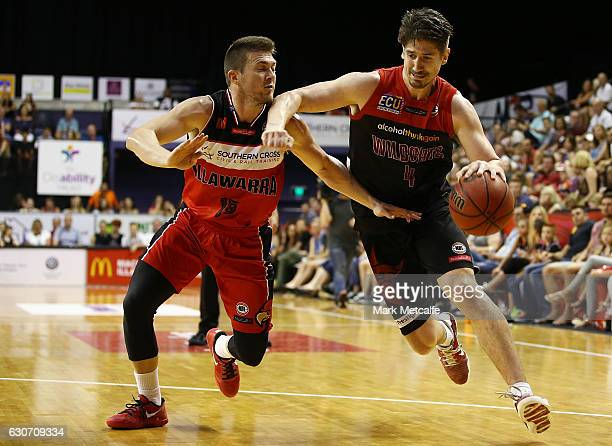 Greg Hire of the Wildcats is challenged by Rotnei Clarke of the Hawks during the round 13 NBL match between Illawarra and Melbourne on December 31...
