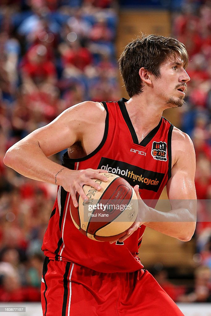 Greg Hire of the Wildcats looks to pass the ball during the round 23 NBL match between the Perth Wildcats and the Cairns Taipans at Perth Arena on March 17, 2013 in Perth, Australia.