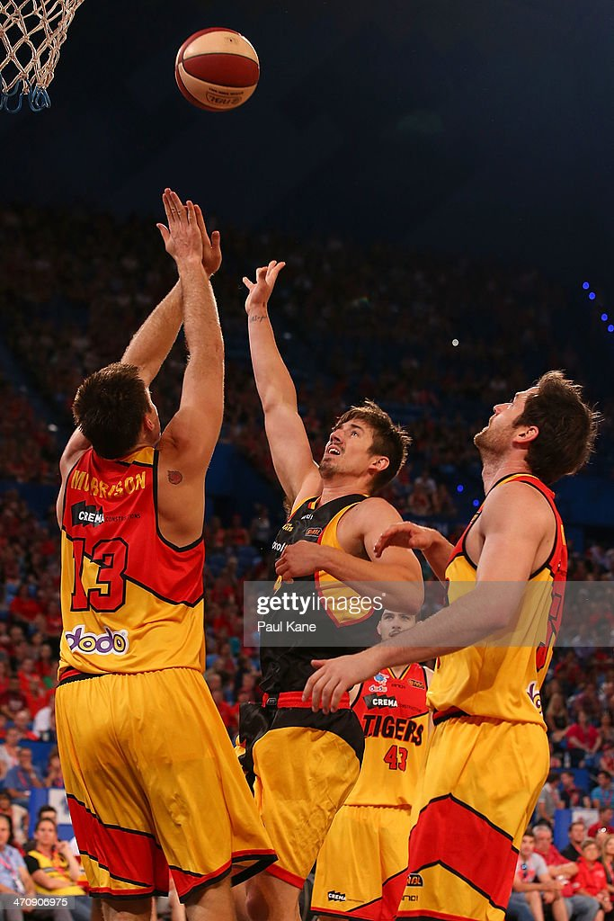 Greg Hire of the Wildcats shoots against Scott Morrison of the Tigers during the round 19 NBL match between the Perth Wildcats and the Melbourne Tigers at Perth Arena on February 21, 2014 in Perth, Australia.