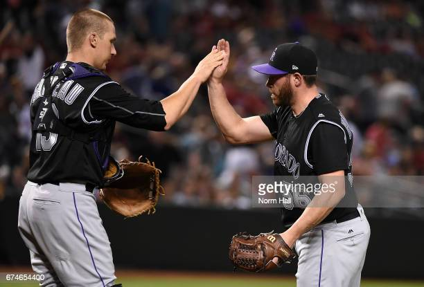 Greg Holland and Dustin Garneau of the Colorado Rockies celebrate a 31 win against the Arizona Diamondbacks at Chase Field on April 28 2017 in...