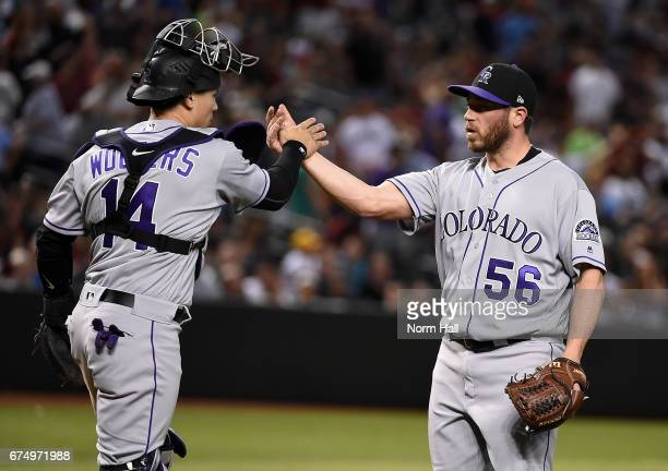 Greg Holland and Tony Wolters of the Colorado Rockies celebrate a 76 win against the Arizona Diamondbacks at Chase Field on April 29 2017 in Phoenix...