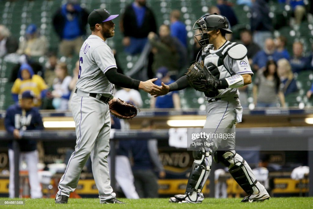 Greg Holland #56 and Tony Wolters #14 of the Colorado Rockies celebrate after beating the Milwaukee Brewers 6-5 at Miller Park on April 4, 2017 in Milwaukee, Wisconsin.