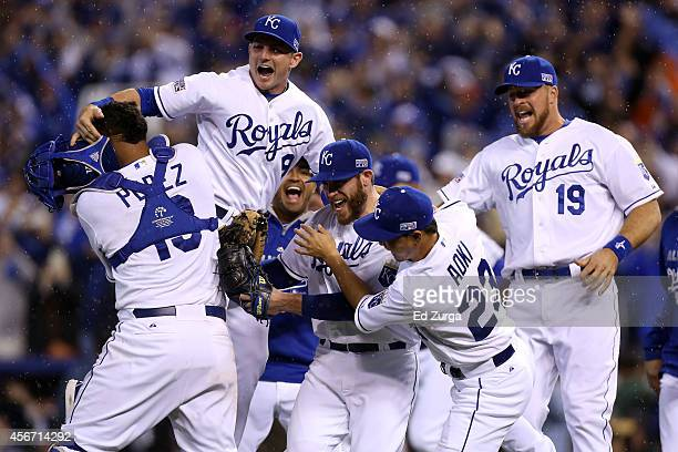 Greg Holland celebrates with Norichika Aoki of the Kansas City Royals after defeating the Los Angeles Angels 83 in Game Three of the American League...