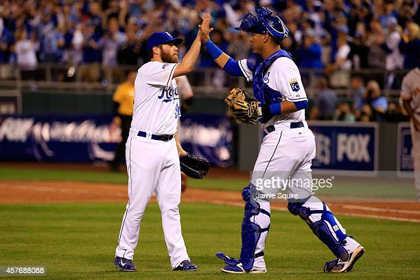 Greg Holland celebrates with Salvador Perez of the Kansas City Royals after defeating the San Francisco Giants 72 in Game Two of the 2014 World...