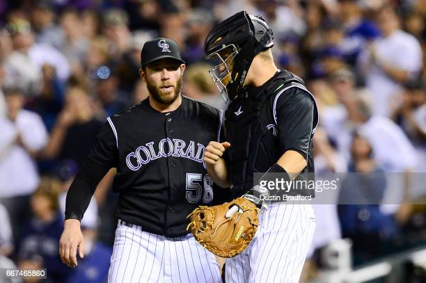 Greg Holland of the Colorado Rockies celebrates a 42 win over the Los Angeles Dodgers with Dustin Garneau after a game at Coors Field on April 8 2017...