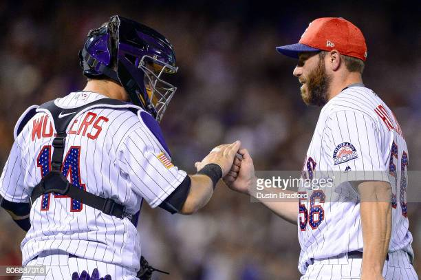 Greg Holland of the Colorado Rockies celebrates a 53 win over the Cincinnati Reds with Tony Wolters after a game at Coors Field on July 3 2017 in...