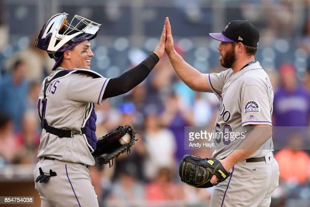 Greg Holland of the Colorado Rockies is congratulated by Tony Wolters after getting the final out during the ninth inning of a baseball game against...