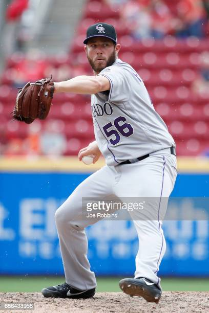 Greg Holland of the Colorado Rockies pitches in the ninth inning of a game against the Cincinnati Reds at Great American Ball Park on May 21 2017 in...