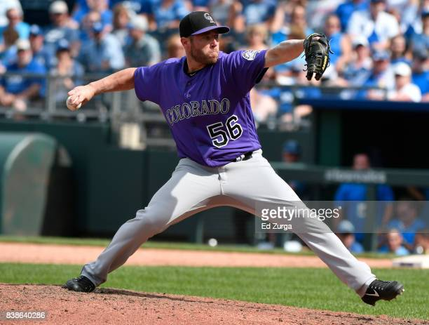 Greg Holland of the Colorado Rockies throws in the ninth inning against the Kansas City Royals at Kauffman Stadium on August 24 2017 in Kansas City...