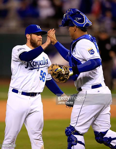 Greg Holland of the Kansas City Royals celebrates with catcher Salvador Perez after closing out the ninth inning to defeat the Baltimore Orioles 2 to...