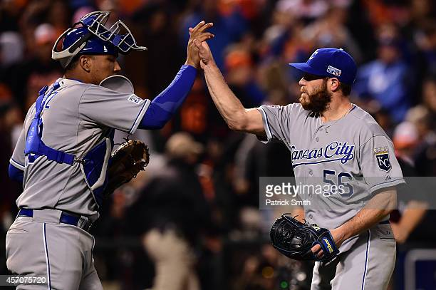 Greg Holland of the Kansas City Royals celebrates with teammate Salvador Perez after closing out the ninth inning to defeat the Baltimore Orioles 6...