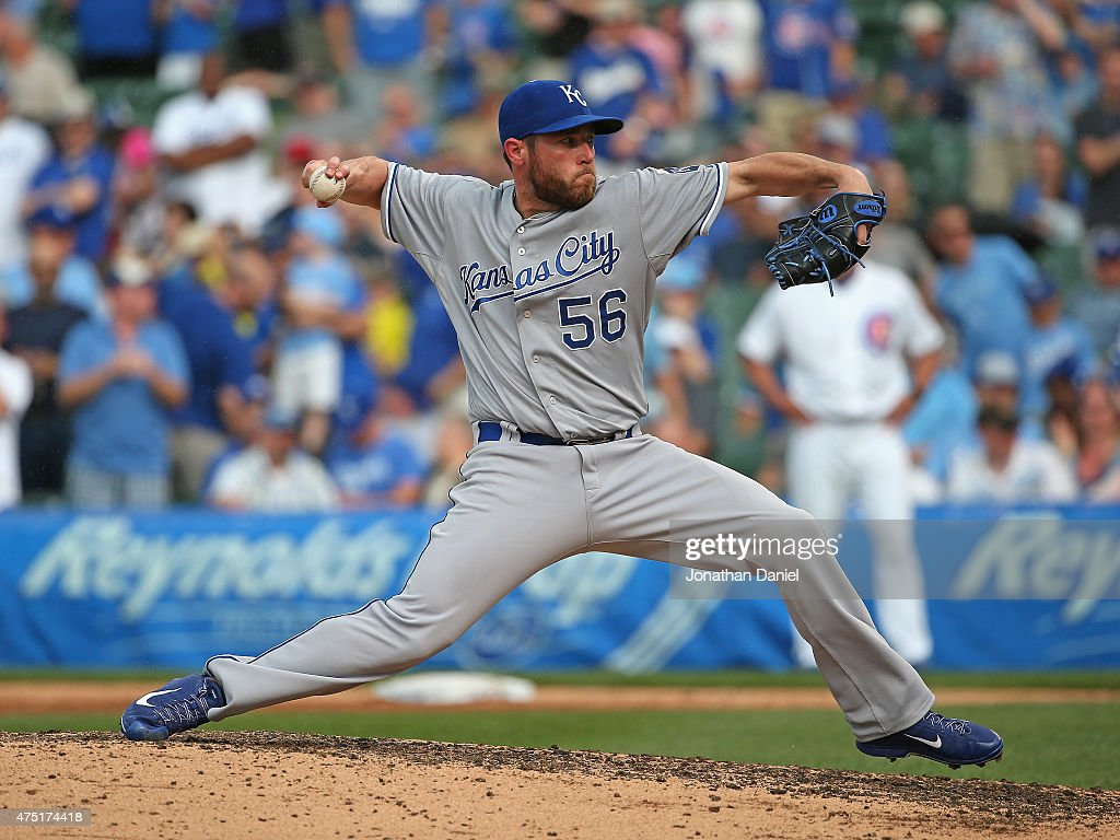 <a gi-track='captionPersonalityLinkClicked' href=/galleries/search?phrase=Greg+Holland+-+Baseball+Player&family=editorial&specificpeople=8603047 ng-click='$event.stopPropagation()'>Greg Holland</a> #56 of the Kansas City Royals pitches in the 9th inning against the Chicago Cubs at Wrigley Field on May 29, 2015 in Chicago, Illinois. The Royals defeated the Cubs 8-4.