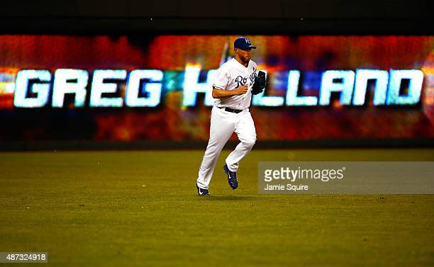 Greg Holland of the Kansas City Royals runs onto the field during the game against the Minnesota Twins at Kauffman Stadium on September 8 2015 in...
