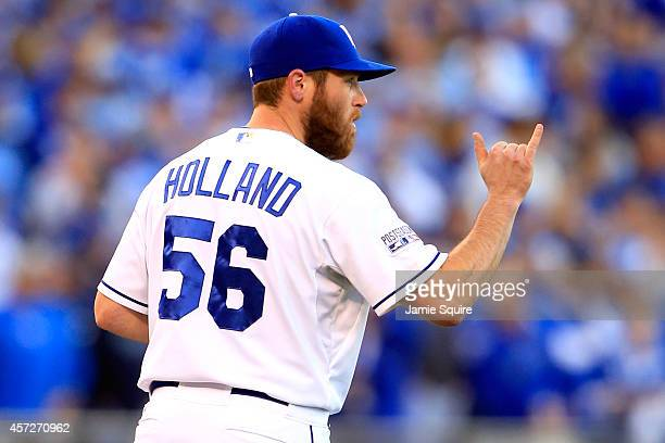 Greg Holland of the Kansas City Royals signals to his teammates in the ninth inning against the Baltimore Orioles during Game Four of the American...