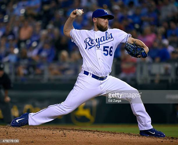 Greg Holland of the Kansas City Royals throws in the ninth inning against the Minnesota Twins at Kauffman Stadium on July 2 2015 in Kansas City...