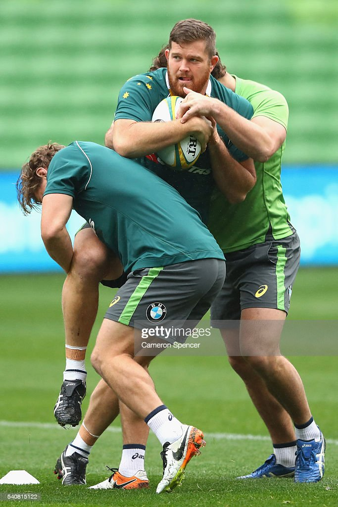 Greg Holmes of the Wallabies is tackled during an Australian Wallabies Captain's Run at AAMI Park on June 17 2016 in Melbourne Australia