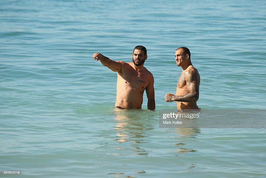 <a gi-track='captionPersonalityLinkClicked' href=/galleries/search?phrase=Greg+Inglis&family=editorial&specificpeople=597192 ng-click='$event.stopPropagation()'>Greg Inglis</a> and <a gi-track='captionPersonalityLinkClicked' href=/galleries/search?phrase=Blake+Ferguson+-+Rugby+Player&family=editorial&specificpeople=11188731 ng-click='$event.stopPropagation()'>Blake Ferguson</a> speak in the water during the Australia Kangaroos Test team recovery session at Coogee Beach on May 2, 2016 in Sydney, Australia.