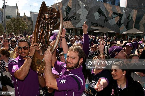 Greg Inglis and Dallas Johnson of the Melbourne Storm hold the NRL Premiership trophy in front of fans during a Civic Reception at Federation Square...