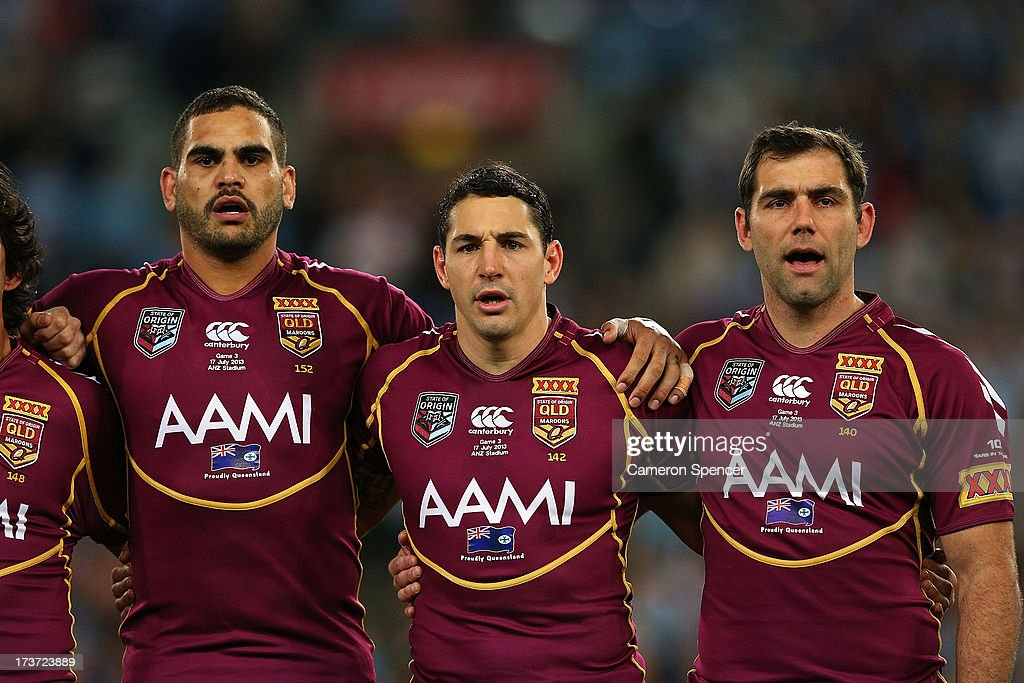 Greg Inglis, Billy Slater and Cameron Smith of the Maroons sings the national anthem before game three of the ARL State of Origin series between the New South Wales Blues and the Queensland Maroons at ANZ Stadium on July 17, 2013 in Sydney, Australia.