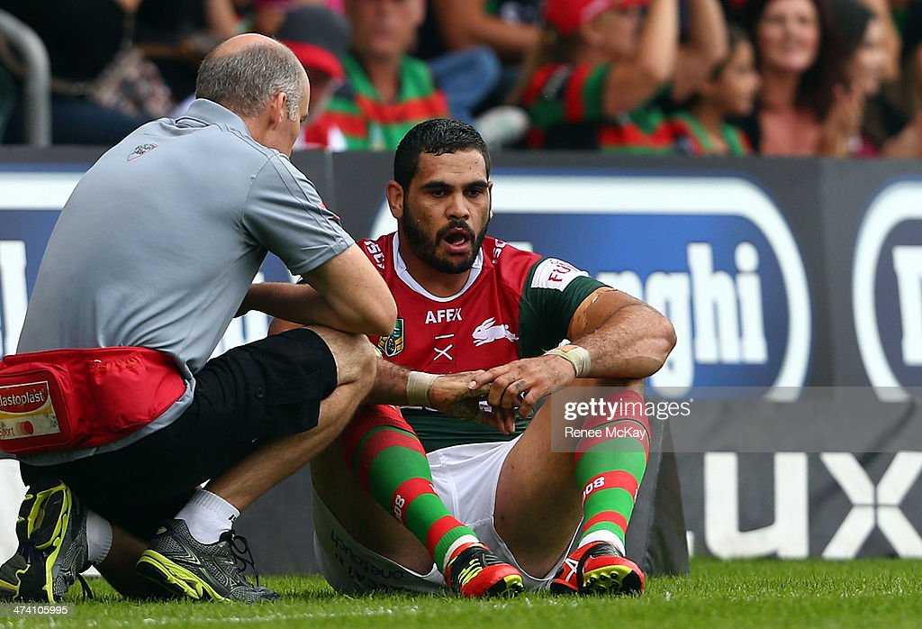 Greg Inglis leaves the field injured during the NRL Charity Shield match between the South Sydney Rabbitohs and the St George Dragons at WIN Stadium on February 22, 2014 in Wollongong, Australia.