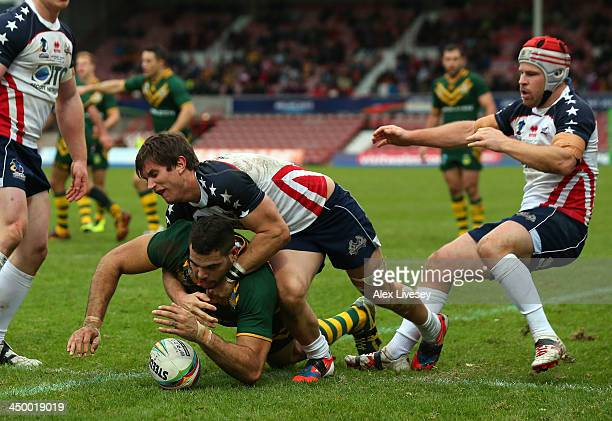 Greg Inglis of Australia dives over the line ahead of Kristian Freed of USA to score his try during the Rugby League World Cup Quarter Final match...