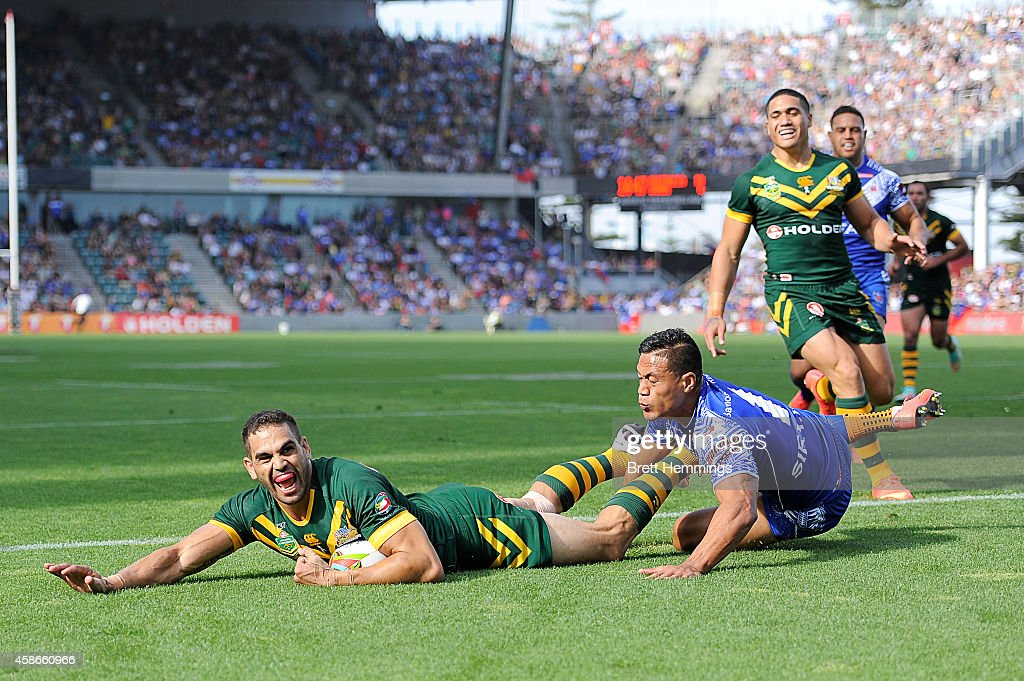 Greg Inglis of Australia scores a try during the Four Nations match between the Australian Kangaroos and Samoa at WIN Stadium on November 9 2014 in...