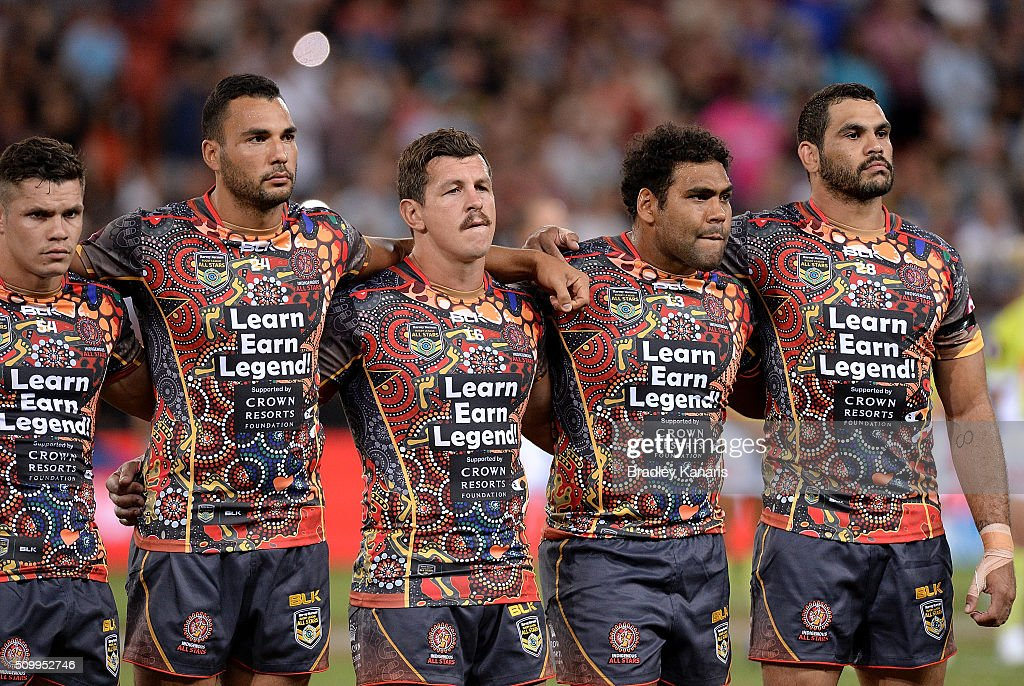 <a gi-track='captionPersonalityLinkClicked' href=/galleries/search?phrase=Greg+Inglis&family=editorial&specificpeople=597192 ng-click='$event.stopPropagation()'>Greg Inglis</a> (R) of the Indigenous All Stars and team mates embrace before the NRL match between the Indigenous All-Stars and the World All-Stars at Suncorp Stadium on February 13, 2016 in Brisbane, Australia.