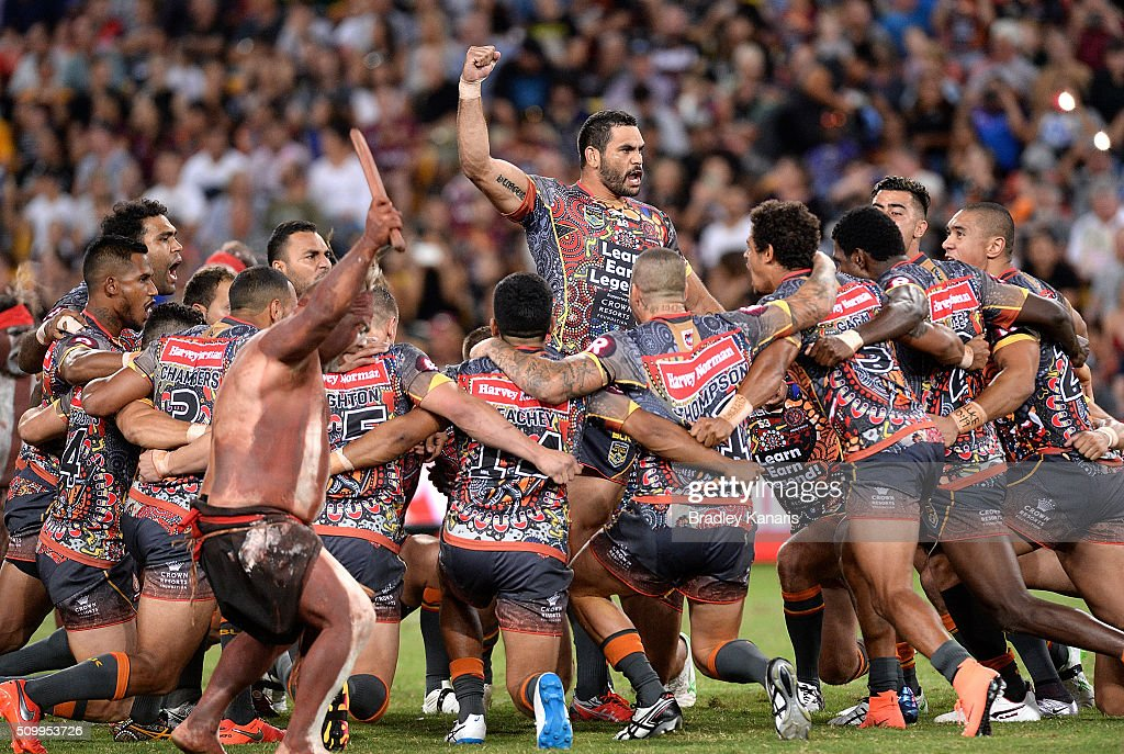 <a gi-track='captionPersonalityLinkClicked' href=/galleries/search?phrase=Greg+Inglis&family=editorial&specificpeople=597192 ng-click='$event.stopPropagation()'>Greg Inglis</a> of the Indigenous All Stars and team mates perform a cultural dance before the NRL match between the Indigenous All-Stars and the World All-Stars at Suncorp Stadium on February 13, 2016 in Brisbane, Australia.