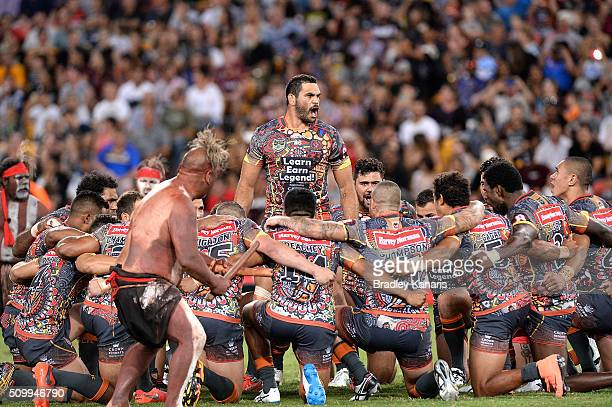 Greg Inglis of the Indigenous All Stars and team mates performs a cultural dance before the NRL match between the Indigenous AllStars and the World...