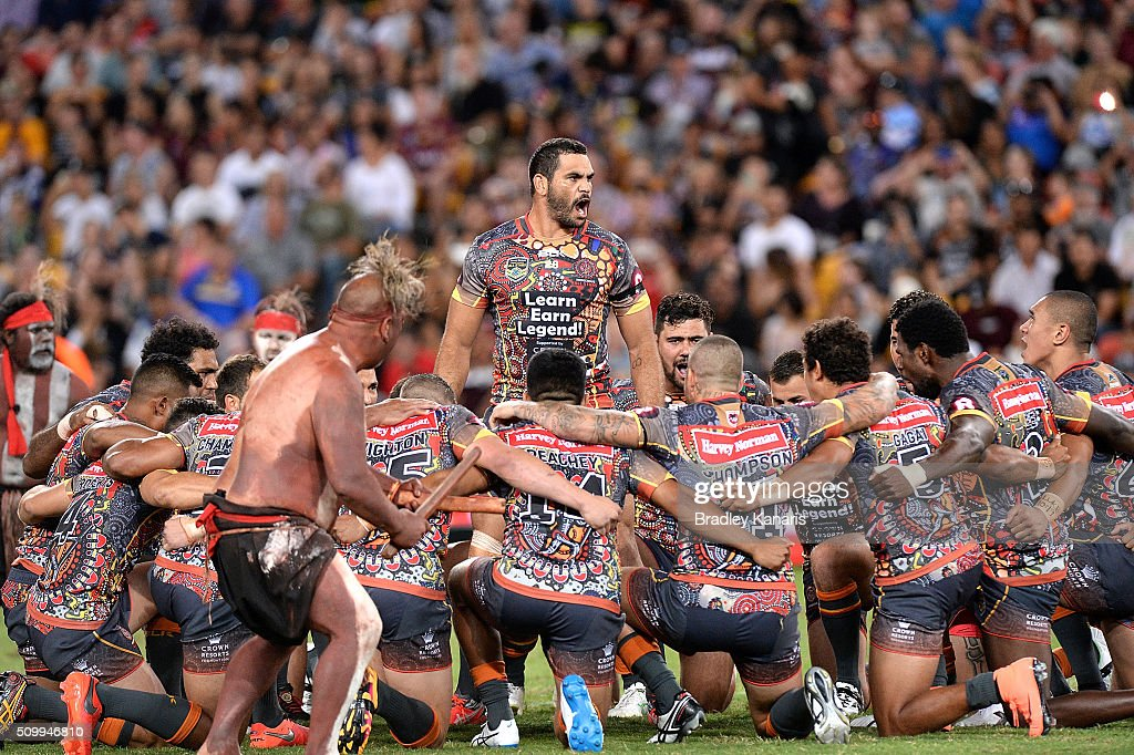 <a gi-track='captionPersonalityLinkClicked' href=/galleries/search?phrase=Greg+Inglis&family=editorial&specificpeople=597192 ng-click='$event.stopPropagation()'>Greg Inglis</a> of the Indigenous All Stars and team mates performs a cultural dance before the NRL match between the Indigenous All-Stars and the World All-Stars at Suncorp Stadium on February 13, 2016 in Brisbane, Australia.