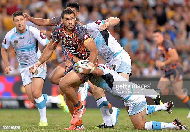 Greg Inglis of the Indigenous All Stars attempts to break through the defence during the NRL match between the Indigenous AllStars and the World...
