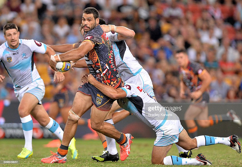 Greg Inglis of the Indigenous All Stars attempts to break through the defence during the NRL match between the Indigenous All-Stars and the World All-Stars at Suncorp Stadium on February 13, 2016 in Brisbane, Australia.