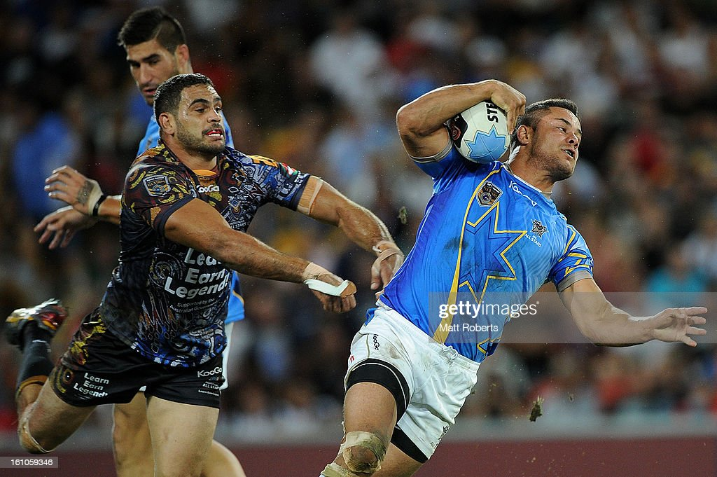 <a gi-track='captionPersonalityLinkClicked' href=/galleries/search?phrase=Greg+Inglis&family=editorial&specificpeople=597192 ng-click='$event.stopPropagation()'>Greg Inglis</a> of the Indigenous All Stars attempts to tackle NRL All Stars during the NRL All Stars Game between the Indigenous All Stars and the NRL All Stars at Suncorp Stadium on February 9, 2013 in Brisbane, Australia.