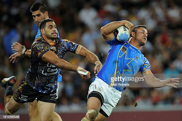 Greg Inglis of the Indigenous All Stars attempts to tackle NRL All Stars during the NRL All Stars Game between the Indigenous All Stars and the NRL...
