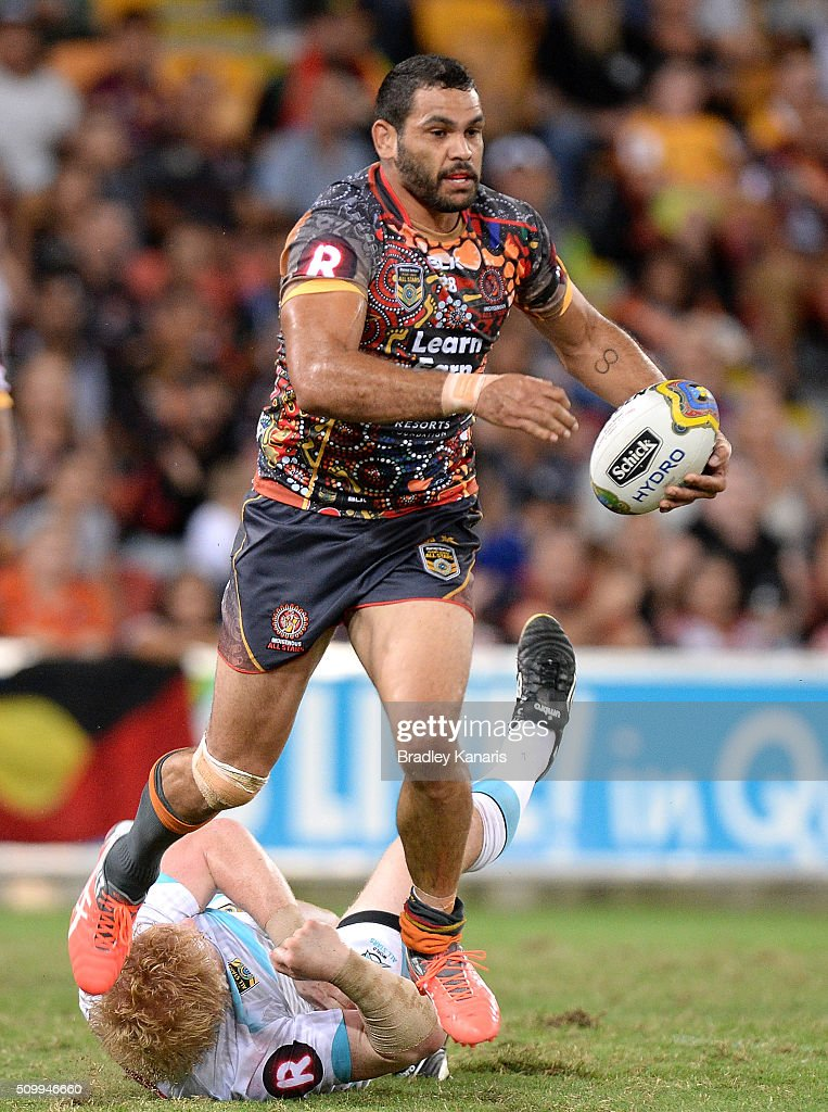 Greg Inglis of the Indigenous All Stars breaks through the defence during the NRL match between the Indigenous All-Stars and the World All-Stars at Suncorp Stadium on February 13, 2016 in Brisbane, Australia.