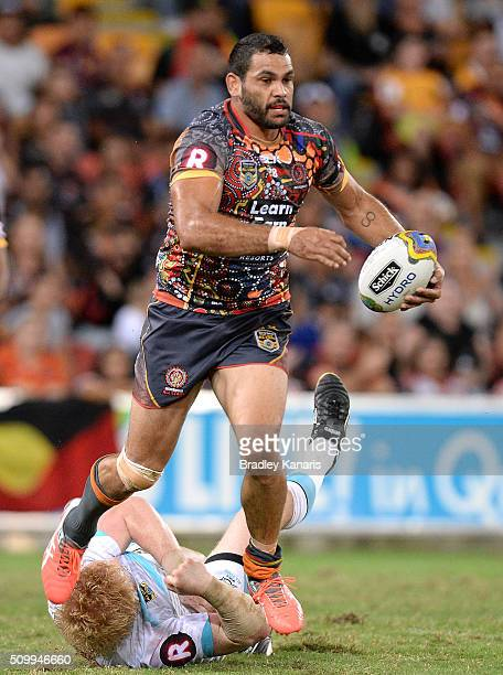 Greg Inglis of the Indigenous All Stars breaks through the defence during the NRL match between the Indigenous AllStars and the World AllStars at...