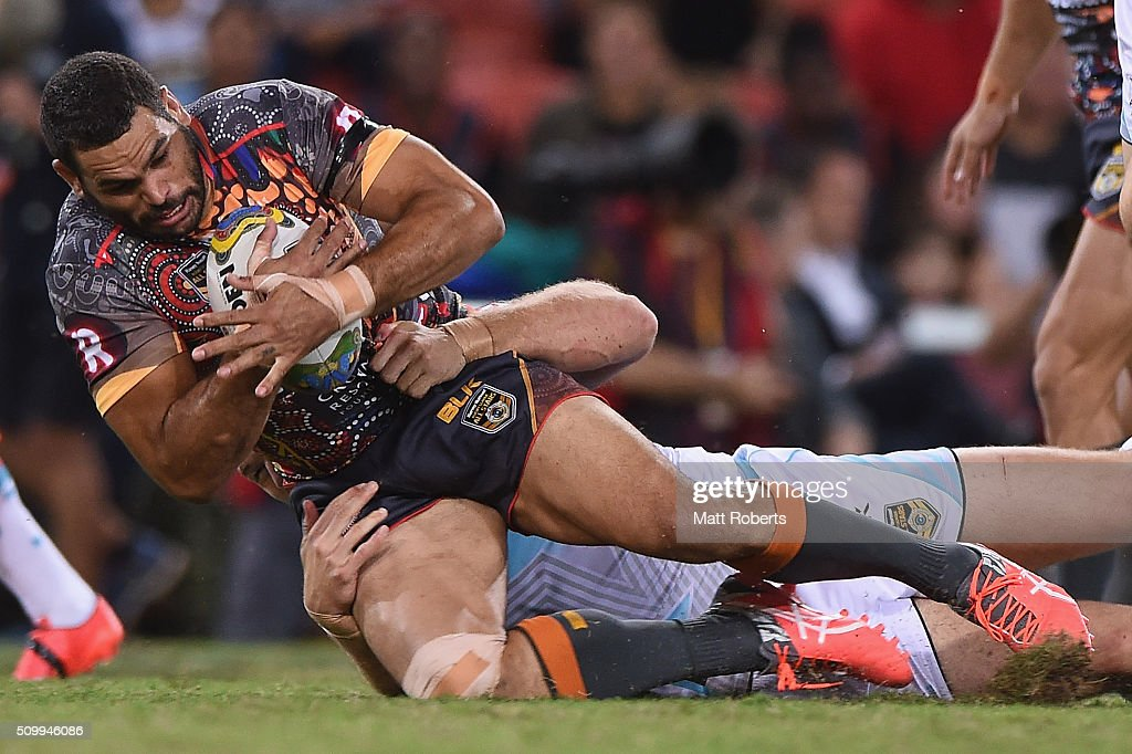 Greg Inglis of the Indigenous All Stars is tackled during the NRL match between the Indigenous All-Stars and the World All-Stars at Suncorp Stadium on February 13, 2016 in Brisbane, Australia.