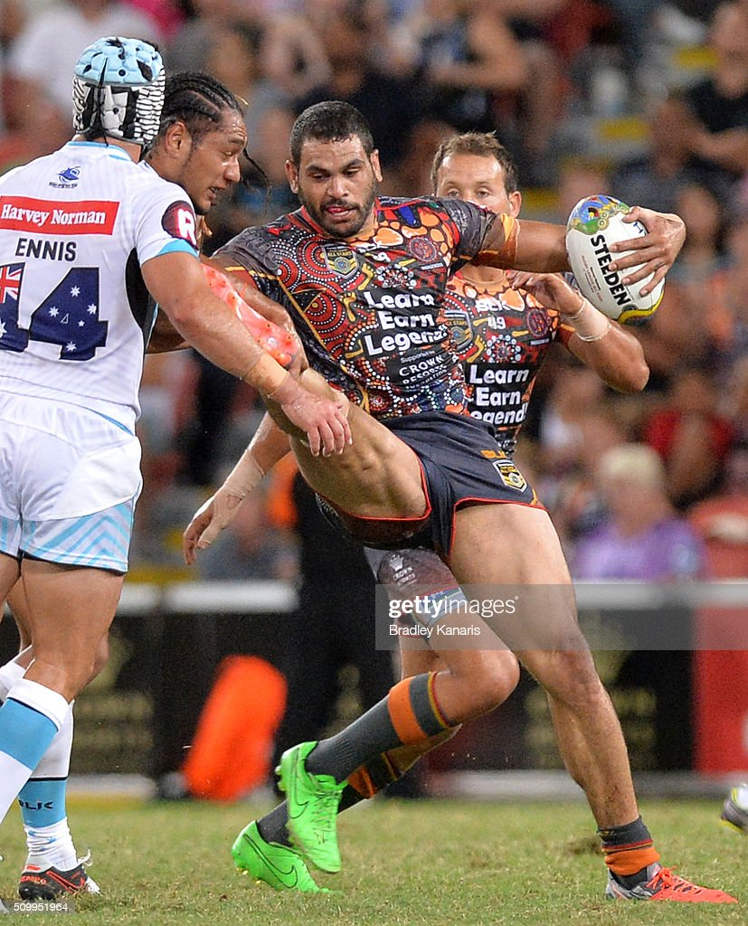 <a gi-track='captionPersonalityLinkClicked' href=/galleries/search?phrase=Greg+Inglis&family=editorial&specificpeople=597192 ng-click='$event.stopPropagation()'>Greg Inglis</a> of the Indigenous All Stars is tackled during the NRL match between the Indigenous All-Stars and the World All-Stars at Suncorp Stadium on February 13, 2016 in Brisbane, Australia.