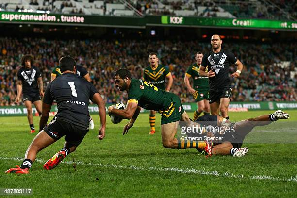 Greg Inglis of the Kangaroos scores a try during the ANZAC Test match between the Australian Kangaroos and the New Zealand Kiwis at Allianz Stadium...