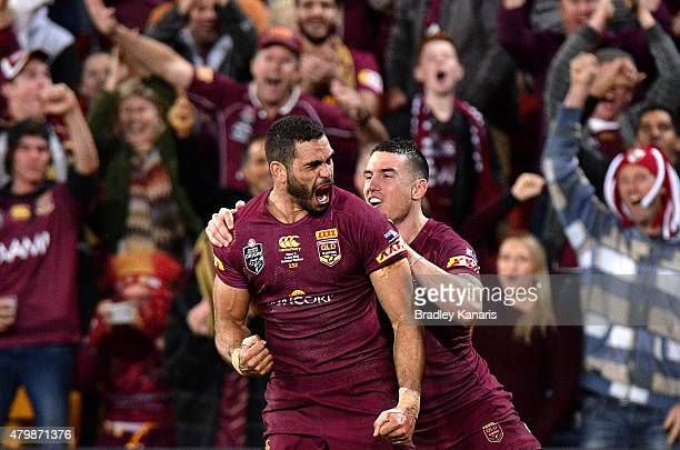 Greg Inglis of the Maroons celebrates scoring a try during game three of the State of Origin series between the Queensland Maroons and the New South...