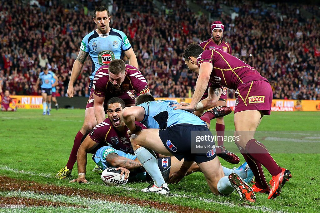 <a gi-track='captionPersonalityLinkClicked' href=/galleries/search?phrase=Greg+Inglis&family=editorial&specificpeople=597192 ng-click='$event.stopPropagation()'>Greg Inglis</a> of the Maroons celebrates scoring a try during game two of the ARL State of Origin series between the Queensland Maroons and the New South Wales Blues at Suncorp Stadium on June 26, 2013 in Brisbane, Australia.