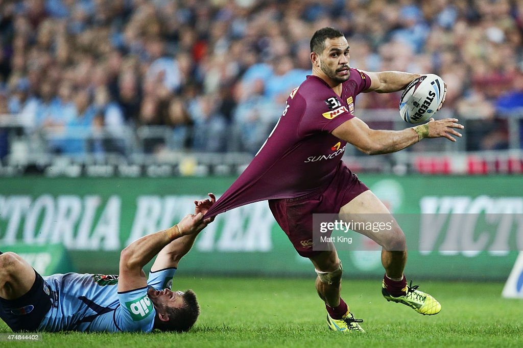 Greg Inglis of the Maroons is tackled by Josh Morris of the Blues during game one of the State of Origin series between the New South Wales Blues and...