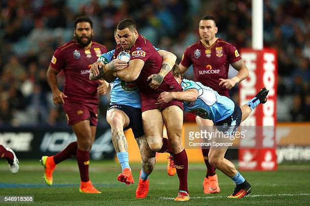Greg Inglis of the Maroons is tackled during game three of the State Of Origin series between the New South Wales Blues and the Queensland Maroons at...