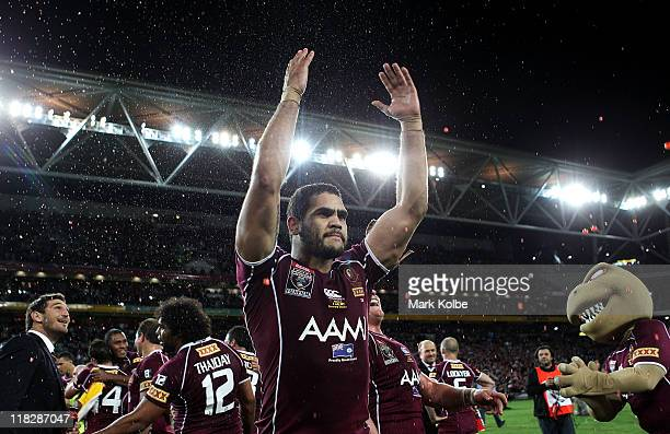Greg Inglis of the Maroons waves to the crowd as he celebrates winning game three of the ARL State of Origin series between the Queensland Maroons...