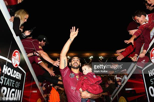 Greg Inglis of the Maroons waves to the crowd as he leaves the field during game three of the State of Origin series between the Queensland Maroons...