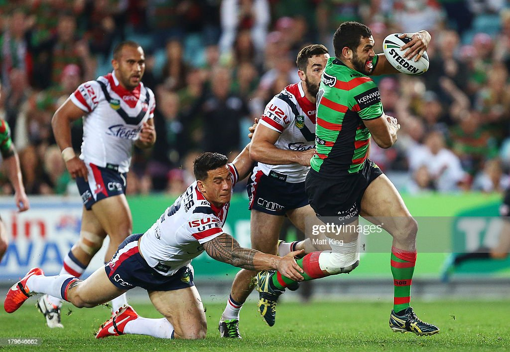 <a gi-track='captionPersonalityLinkClicked' href=/galleries/search?phrase=Greg+Inglis&family=editorial&specificpeople=597192 ng-click='$event.stopPropagation()'>Greg Inglis</a> of the Rabbitohs beats the tackle of Sonny-Bill Williams of the Roosters to score a try during the round 26 NRL match between the South Sydney Rabbitohs and the Sydney Roosters at ANZ Stadium on September 6, 2013 in Sydney, Australia.