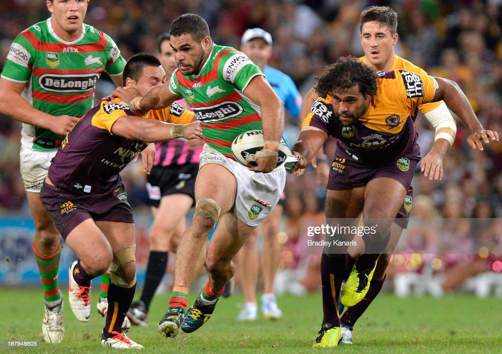 Greg Inglis of the Rabbitohs breaks through the defence during the round eight NRL match between the Brisbane Broncos and the South Sydney Rabbitohs...