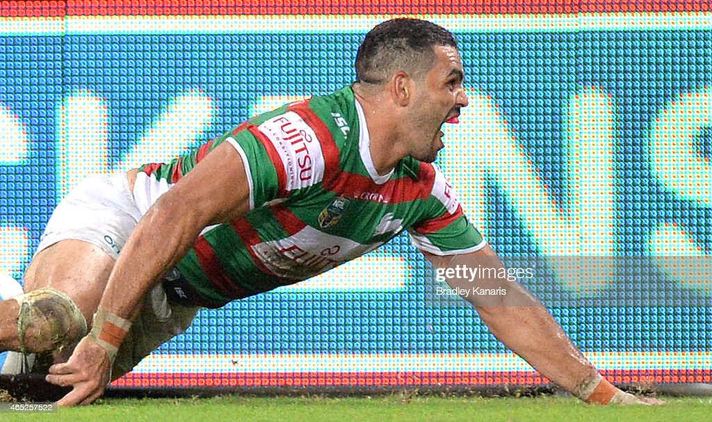 Greg Inglis of the Rabbitohs celebrates scoring a try during the round one NRL match between the Brisbane Broncos and the South Sydney Rabbitohs at...